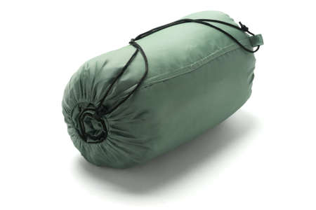 Sleeping Bag Packed In A Sack Lying On White Background