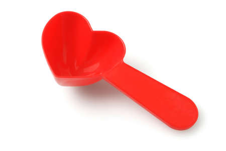 measuring spoons: Heart Shape Milk Powder Spoon On White Background