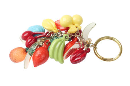 key chain: Key Chain With Plastic Fruit Trinket On WHite Background