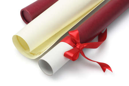 Graduation Certificate and Open Scroll Container On White Background photo