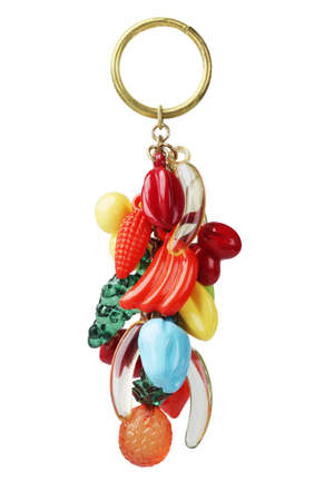 trinket: Key Chain With Plastic Fruits Trinket On White Background Stock Photo