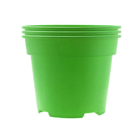 flower in pot: Stack of Green Plastic Flower Pots on White Background