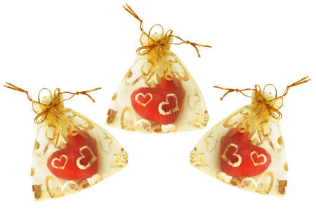 sachets: Red Love Hearts in Golden Sachets on White Background