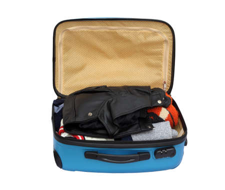 open suitcase: Open Suitcase Packed With Warm Clothing on White Background Stock Photo