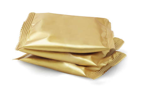wrappers: Stack of Candy in Sealed Golden Colour Wrappers on White Background
