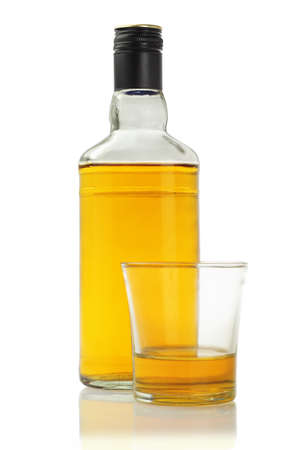spirits: A Glass and Bottle of Alcoholic Drink on White Background