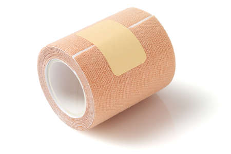 therapeutic: Roll of Elastic Therapeutic Tape on White Background Stock Photo