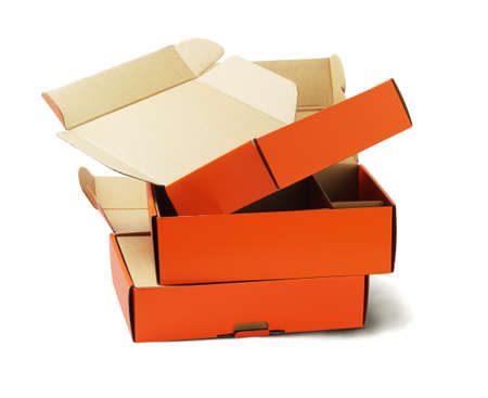 discarded: Discarded Orange Product Package Boxes for Recycling on White Background Stock Photo