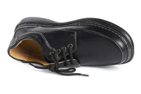 Black Leather Shoe Lying on White Background
