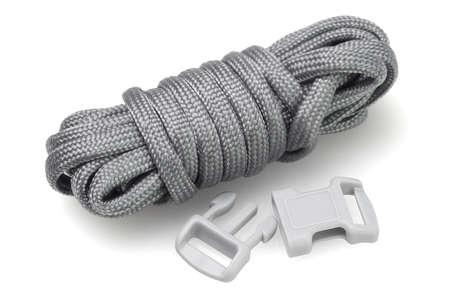 Para Cord Survival Bracelet Kit on White Background Stock Photo