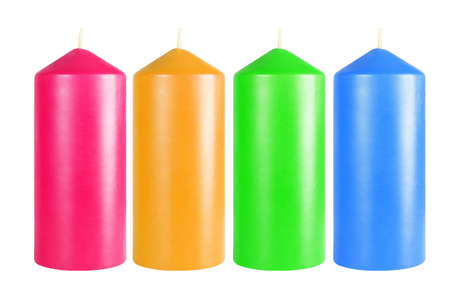Row of Decorative Colourful Candles on White Background Imagens