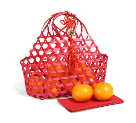 Chinese New Year Gift Basket of Mandarin Oranges and Red Packets on White Background