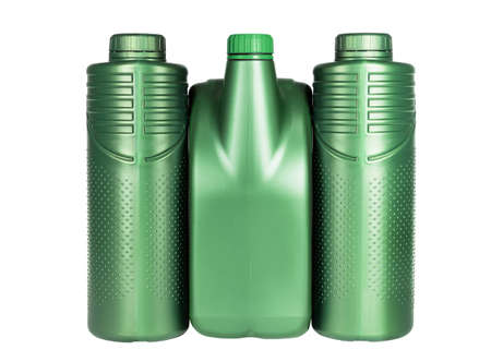 Row of Green Plastic Containers for Engine Lubricants on White Background 免版税图像