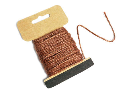 Hemp Rope Wound Up on Card With Loose End on white Background 免版税图像