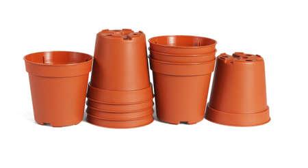 A Row of Mini Plastic flower Pots on White Background 免版税图像