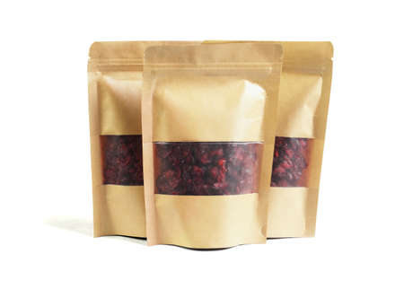 Dried Cranberries in Paper Packs on White Background 免版税图像