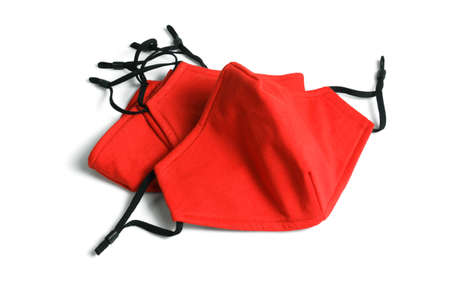 Red Fabric Face Masks on White Background 免版税图像