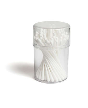 Cotton Buds in Plastic Container on White Background 免版税图像
