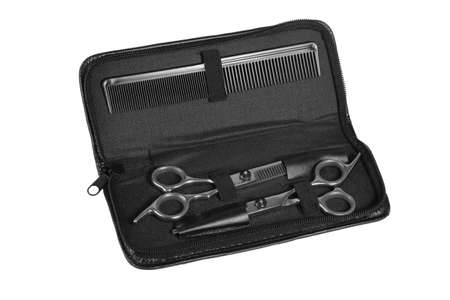 Hairdresser Tool Set in Open Bag on White Background