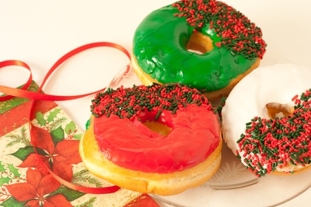 Donuts for the holiday season with red, green and white icing and sprinkles.
