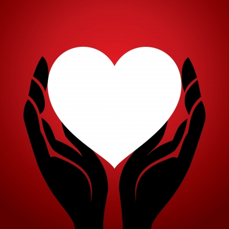 white heart in hand