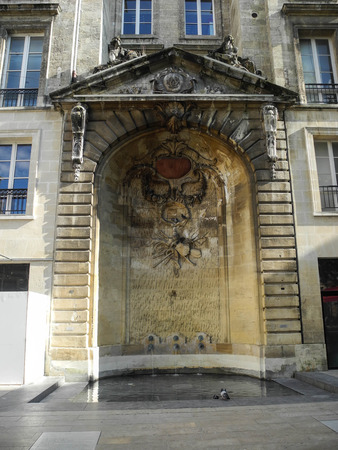 Fountain, Place St-Projet, The front of the base is decorated with an old crossroad rype cross, Bordeaux France