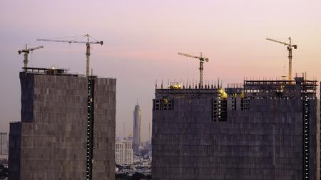 buliding: evening time of High buliding Construction site, Bangkok Thailand Stock Photo