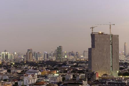 buliding: night time view of High buliding Construction site, Bangkok Thailand