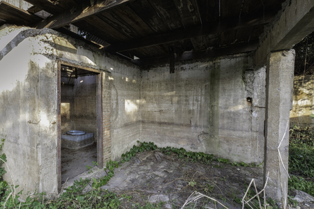 latrine: view of deserted toilet house