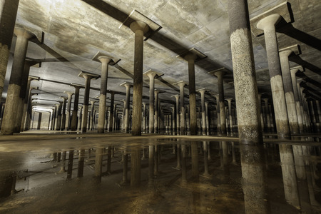 confined space: confined space area, reinforced column reflection, underground tank Stock Photo