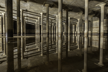 cs: confined space area, reinforced column reflection, underground tank Stock Photo