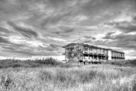 black and white of deserted building photo