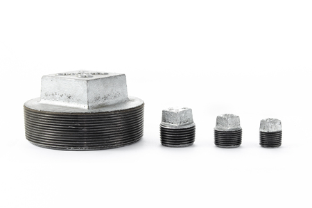 snap: different size of  galvanized iron hole plug for waterwork, snap bushing, close end wire conector Stock Photo