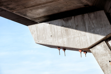 uplift: Long stud bolts will function as fastening concrete box girder against uplift or overturning