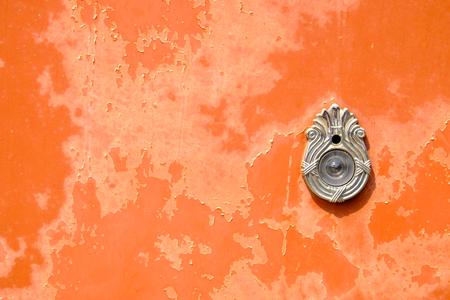 peephole: Peephole on orange door