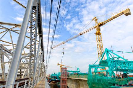 metre: tower crane carry concrete bucket, 1.5 Cubic metre Stock Photo