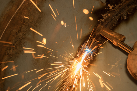 ductile: gas cutter, steel water pipe Stock Photo
