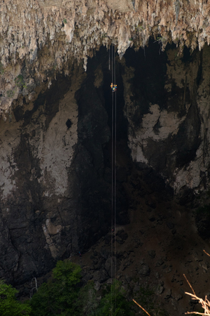 abseil: abseiling activity at Sinkhole{Spirit Well Cave} 140 metre of high, Mea Hong Sorn province, Thailand