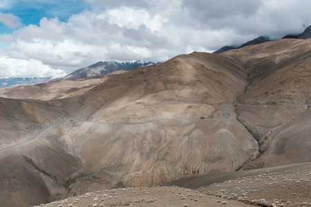 highway 3: small truck driving along 1D highway Srinagar to Kagil route, view of Namikala point , 3,660 m (msl), India