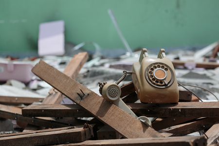 superannuated: the end of analog telephone in destroyed roomm Stock Photo