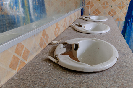 dirty and broken of sink in rest room