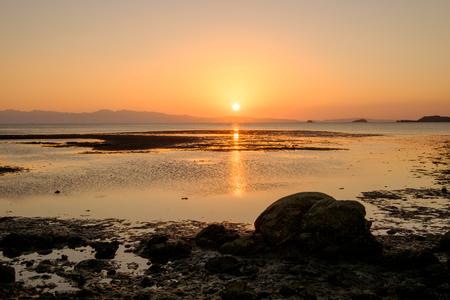 ebb tide and sunset at Bakunyai island, Satun province , Thailand