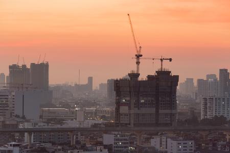 crane bucket: high building construction site along sky train line, Bangkok Thailand