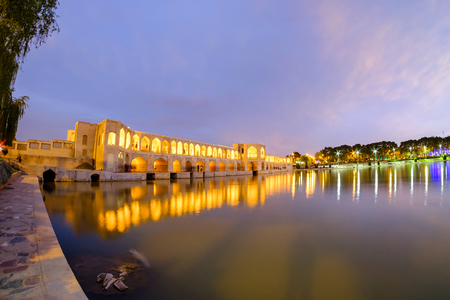in vacation time or weekend many peole of Iranian are rest at Pol-e Khaju 132 meter  long over Zayande river , 1500 years ago, Esfahan, Iran