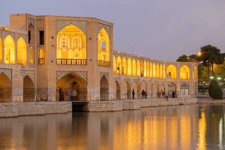 Iranian are rest at Pol-e Khaju bridge, 132 meter  long over Zayande river , since 1500 years ago, Esfahan, Iran 스톡 콘텐츠