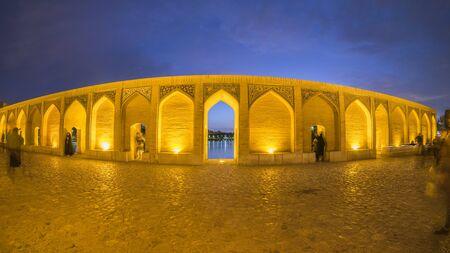 Iranian are rest at Pol-e Khaju bridge, 132 meter  long over Zayande river , since 1500 years ago, Esfahan, Iran Stock Photo