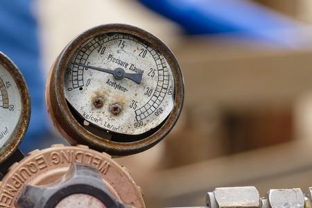 old and broken pressure gauge