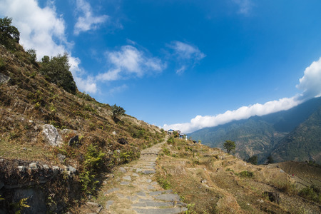 side walk  and machapuchare mountain in the middle, Annapurna conversation area, Nepal Stock Photo