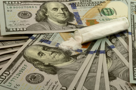 illegal drug: 100 dollar bills with a pile of white powder. Drugs