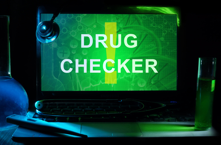 checker: Notebook with words   Drug Checker Stock Photo